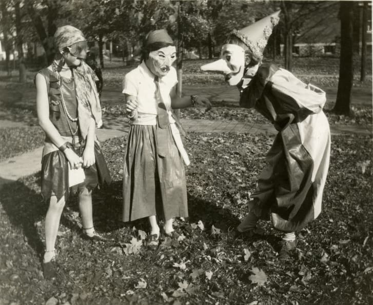 Three girls prepare for Halloween festivities in the College Hill neighborhood of Cincinnati, Ohio, 1929.