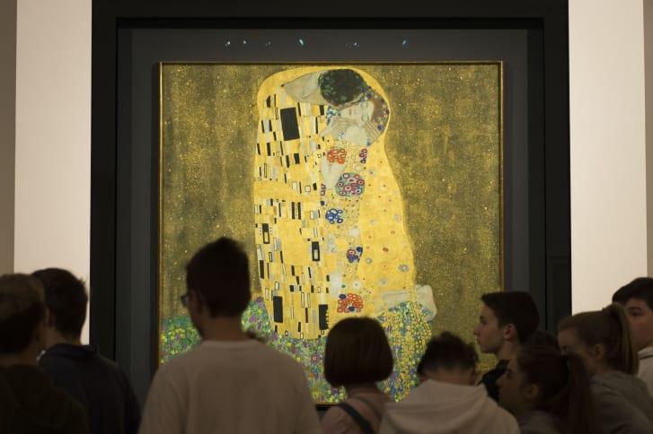 "Visitors admire ""The Kiss"" by Gustav Klimt at the Upper Belvedere in Vienna, Austria."
