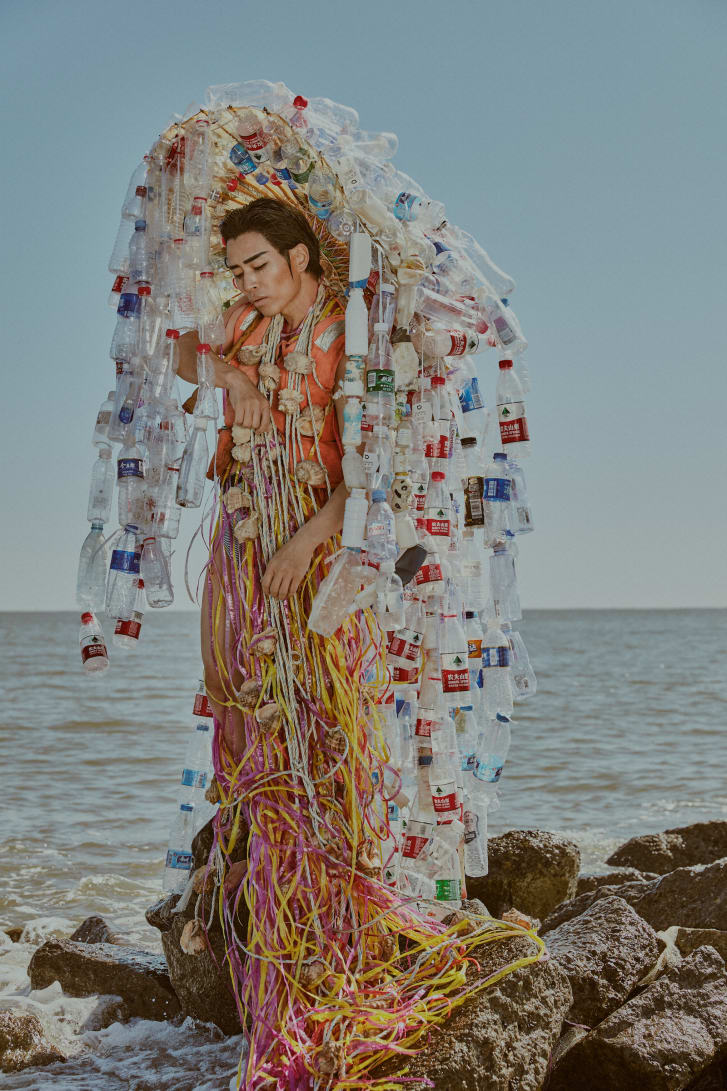 An elaborate outfit made from discarded plastic bottles.
