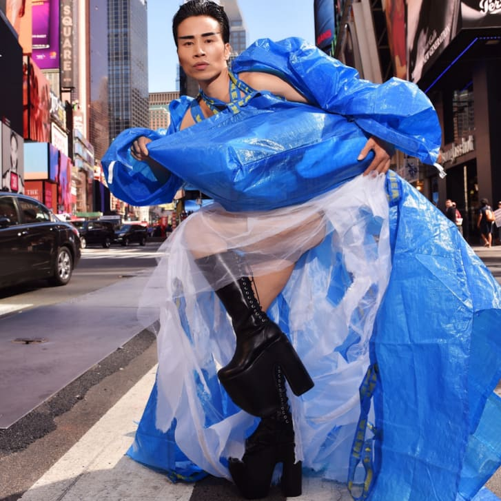 An image taken in New York's Times Square shows Wan dressed in a bright blue gown made of IKEA shopping bags.