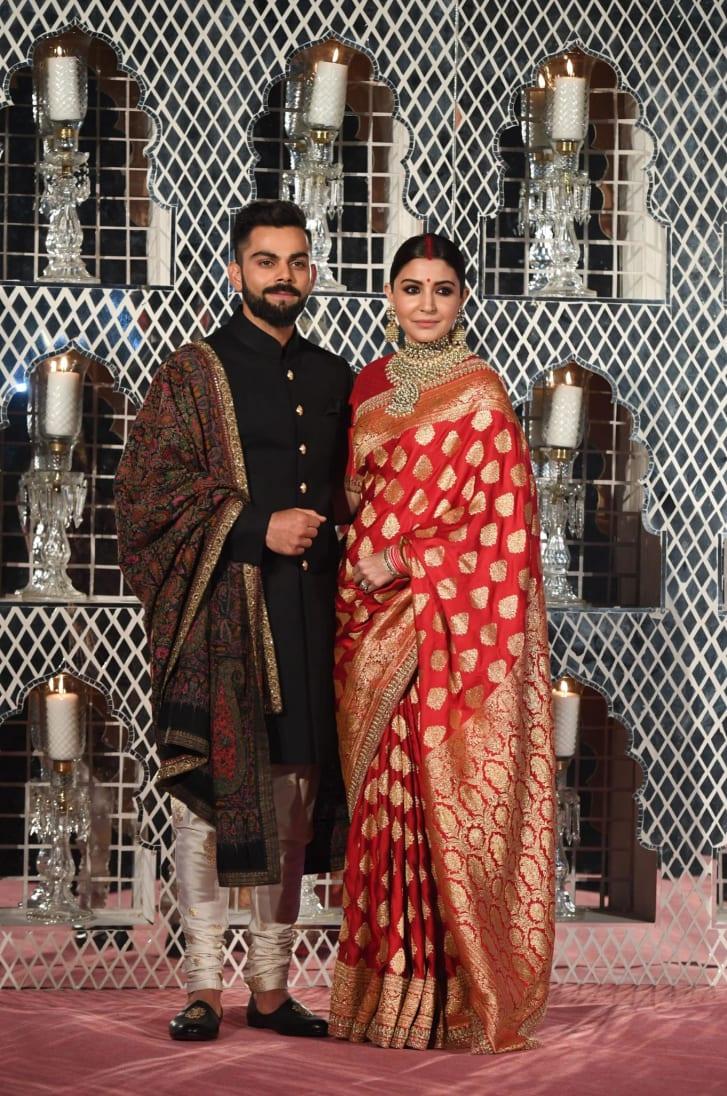 Bollywood actress Anushka Sharma wears a Banarasi sari to her wedding to Indian cricketer Virat Kohli in New Delhi on December 21, 2017.