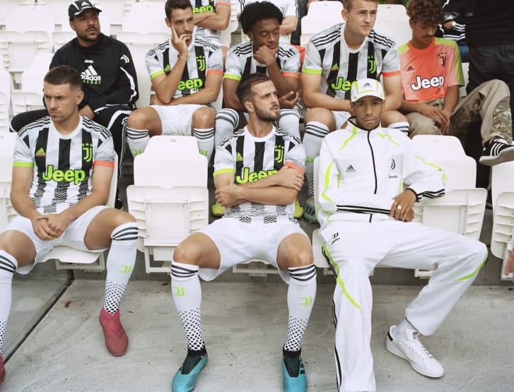 Juventus squad members in the new jerseys and training gear.