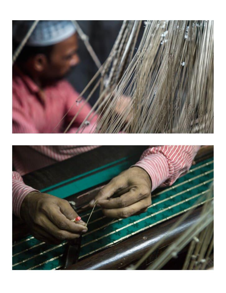 A silk weaver weaves gold zari into silk fabric at his pit handloom in Varanasi, India.