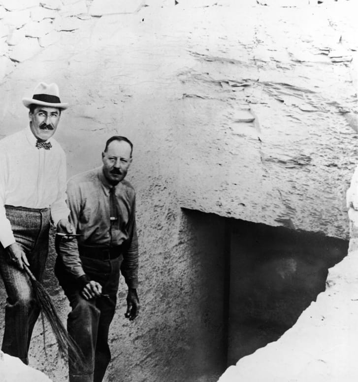 British Egyptologist Howard Carter (left)                        pictured on the steps leading to Tutankhamun's                        tomb with his assistant Arthur Callender.