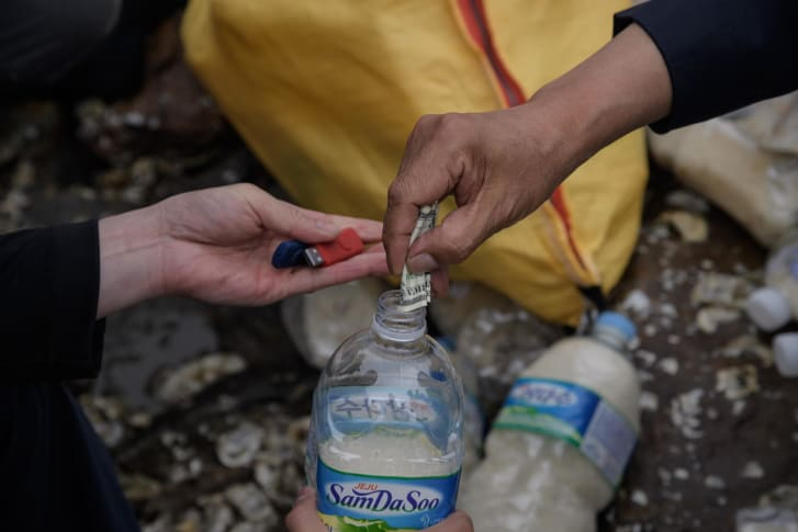 Activists fill water bottles with rice, cash and K-pop-filled USB sticks to be thrown into the sea towards North Korea on Ganghwa island, South Korea in 2018.