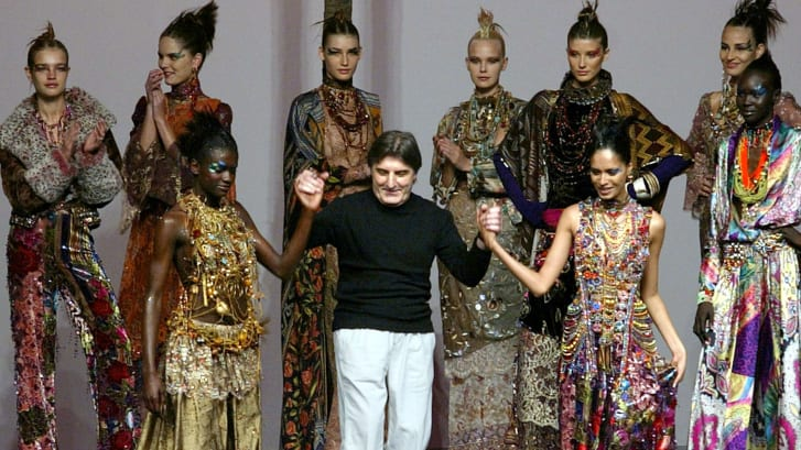 French designer Emanuel Ungaro appears with his models at the end of his Autumn-Winter 2002-2003 high fashion collection in Paris, France on July 10, 2002.