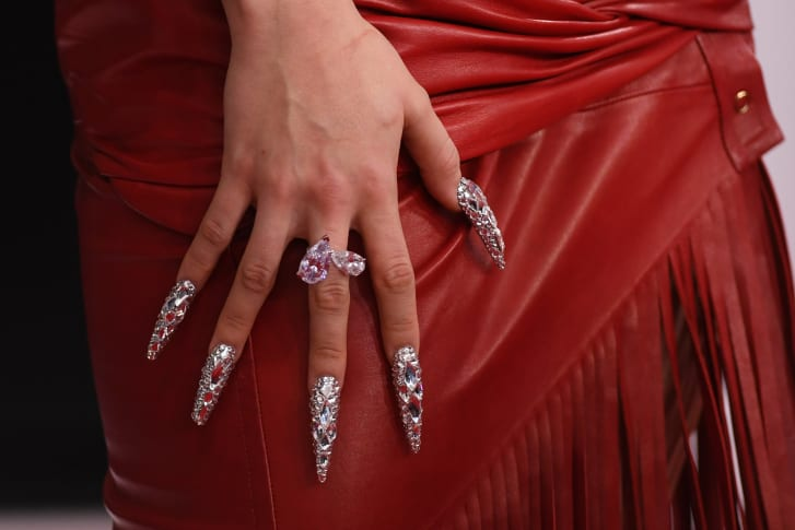 Close up of Rosalia's ornate nails.