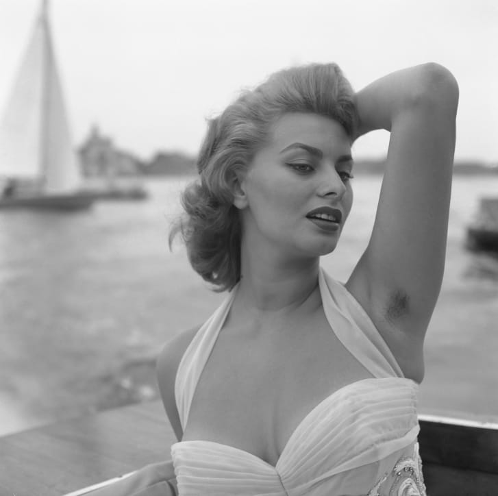 Italian actress Sophia Loren, wearing a white embroidered dress, posing for the photographer in Venice, 1955.