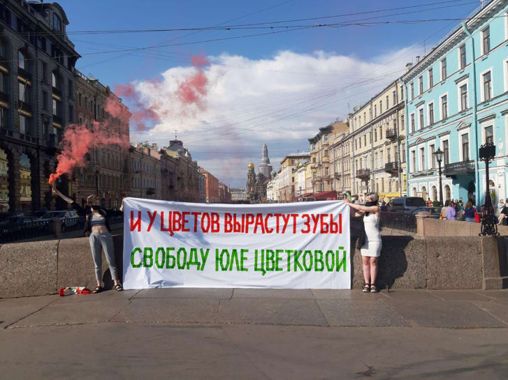 "A protest in support of Yulia Tsvetkova in Saint Petersburg, Russia. The banner reads: ""Even the flowers will begin to bite: Freedom for Yulia Tsvetkova."" (This is a play on Tsvetkova's last name, which can be translated from Russian as 'flower')"