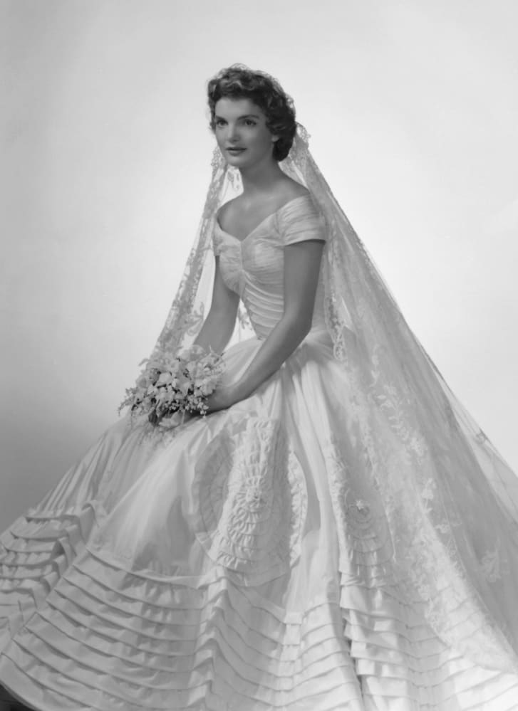 This bridal portrait of Jackie Kennedy captures the finery of her Ann Lowe-designed wedding dress.