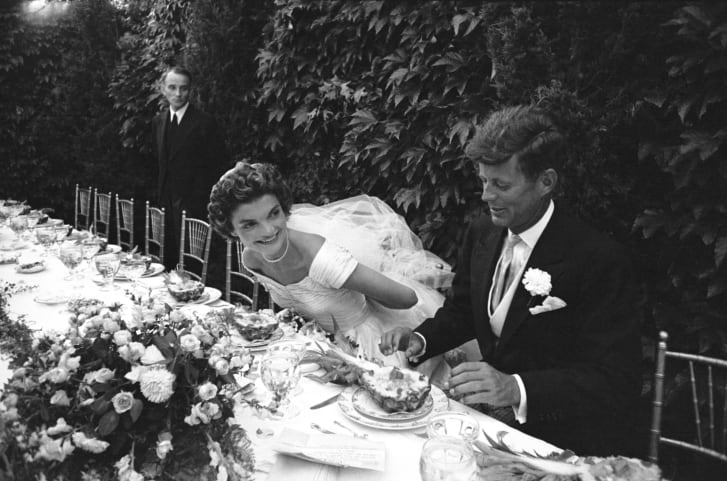 Jackie and John Kennedy are shown in their wedding attire.