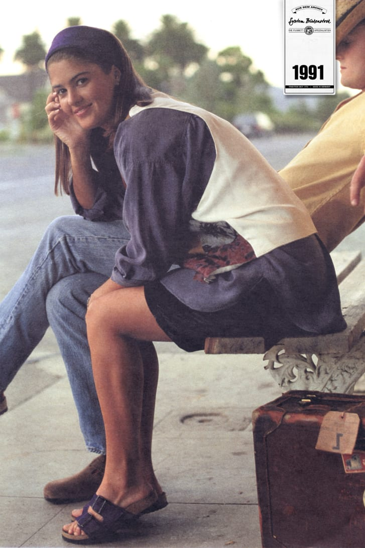 A model wears the classic two-strap Arizona sandal for a Birkenstock poster, 1991