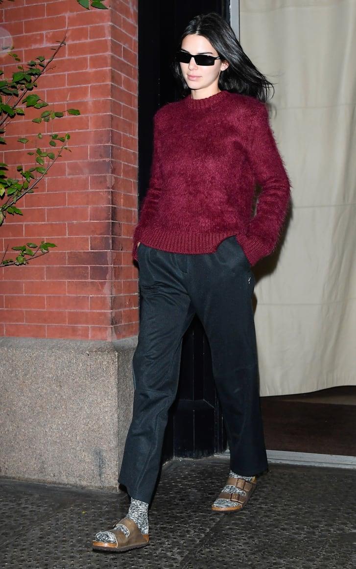 Kendall Jenner wearing Birkenstocks with socks in SoHo, New York City