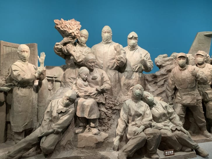 A large statue depicts workers involved in China's Covid-19 response.