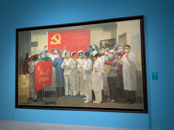 A painting of jubilant medical workers, reminscent of the style of Socialist Realism used in revolutionary artworks.