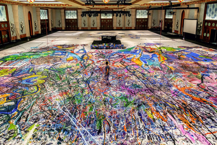 Artist Sacha Jafri at work, in a hotel ballroom in Dubai, on what is expected to be the world's largest painting