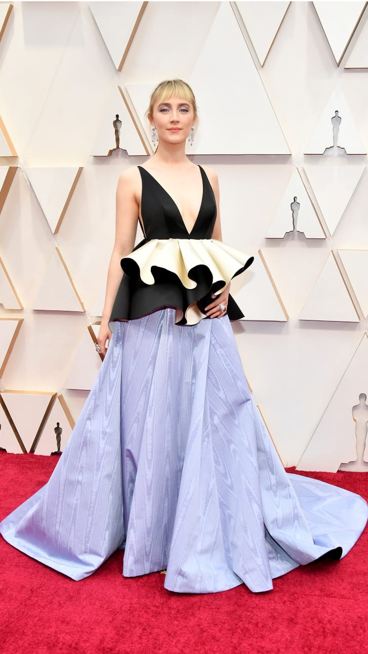Saoirse Ronan attended the 92nd  Oscars in a gown made, partly, with leftover fabric from her Baftas dress earlier that month.