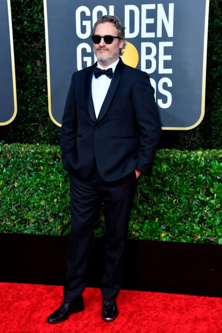 Joaquin Phoenix wore the same Stella McCartney tuxedo to successive awards ceremonies.