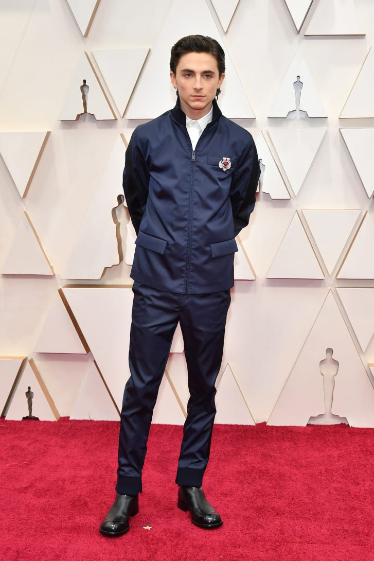 Timothée Chalamet's Prada outfit at the 2020 Oscars was made using yarn made from regenerated nylon, created from materials such as ocean plastics, fishing nets and textile fiber waste. A vintage Cartier brooch finished the look.