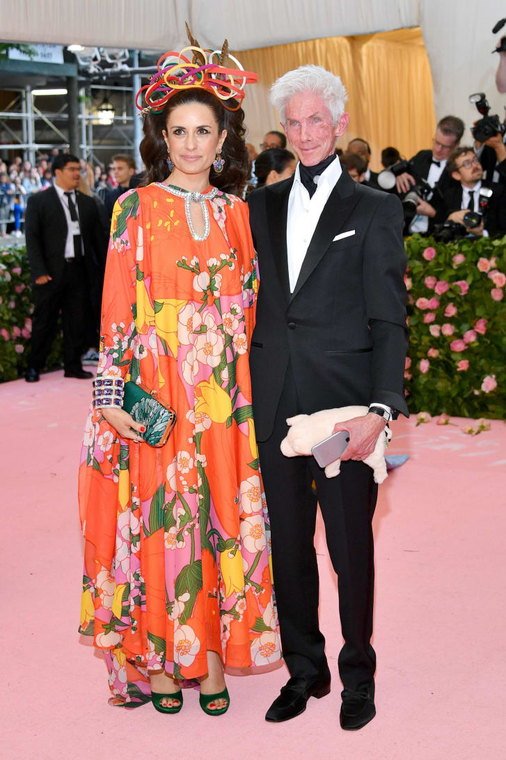 Livia Firth's custom tangerine caftan by Richard Quinn for the 2019 Met Gala featured recycled plastic bottles and Swarovski upcycled crystals.