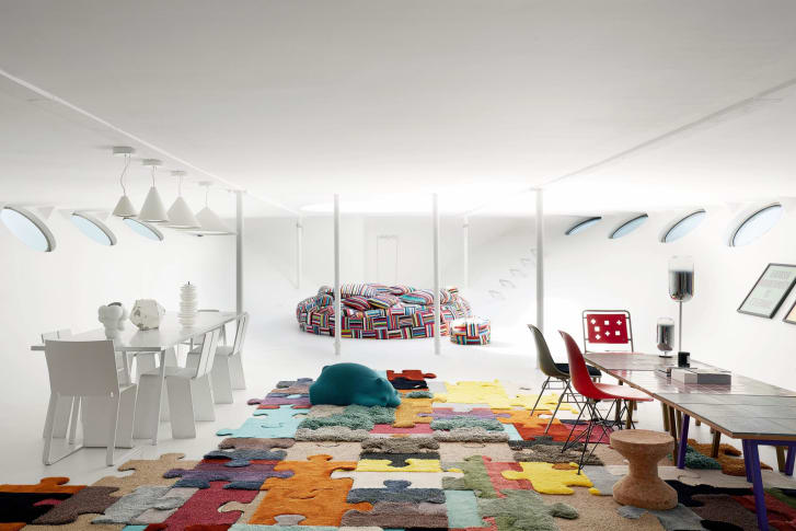 The family playroom features patchwork beanbags and pillows