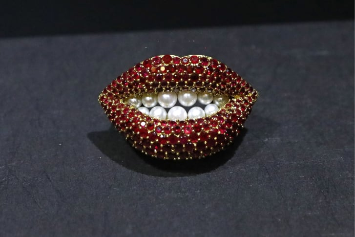 """""""Ruby Lips"""" ruby and cultured pearl brooch, designed by Salvador Dali."""