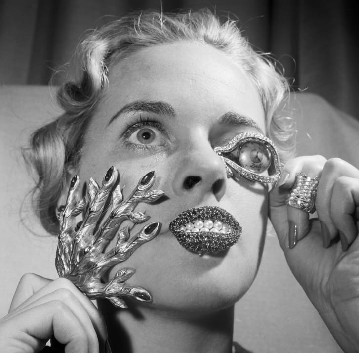 Madelle Hegeler shows off jewelry by Salvadore Dali in New York.
