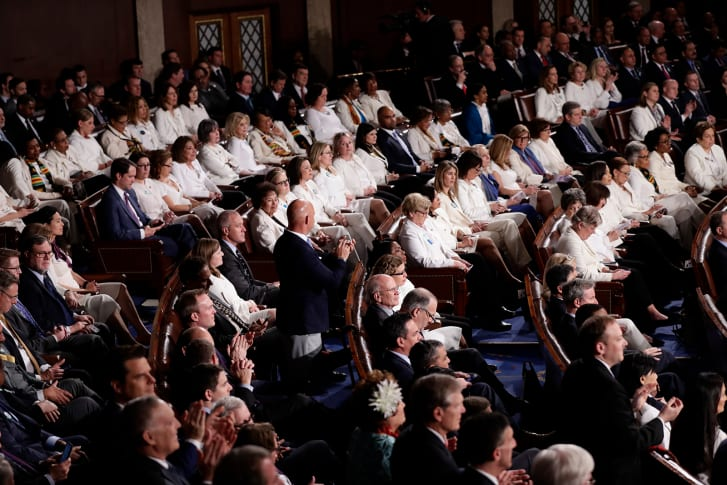 Democratic representatives dressed in white during President Donald Trump's State of the Union address in February 2020.