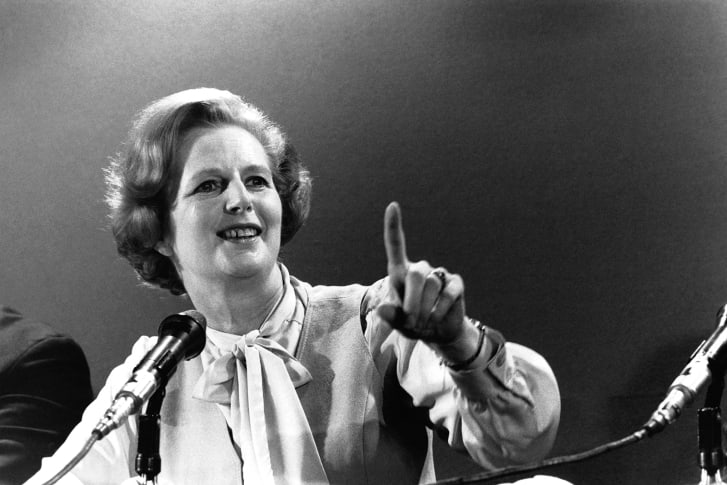 Margaret Thatcher sporting her signature pussy bow.