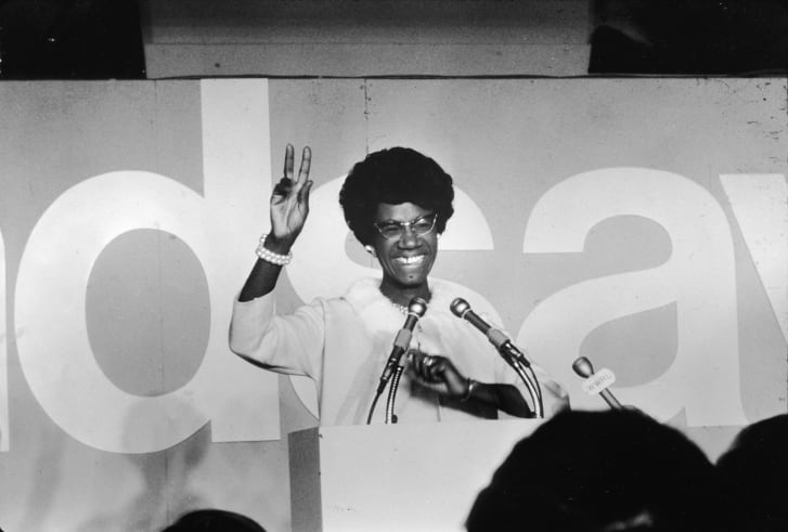 Shirley Chisholm, the first African American woman to be elected to Congress, dressed in all-white.
