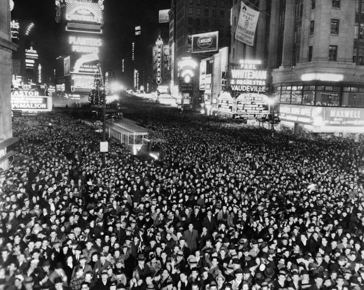Crowds gather in Times Square to on December 31, 1938. The intersection has hosted New Year's Eve celebrations since 1904.