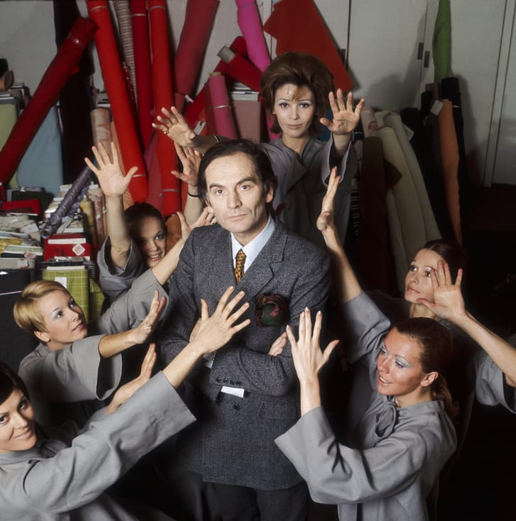 Pierre Cardin stands in his studio surrounded by models.