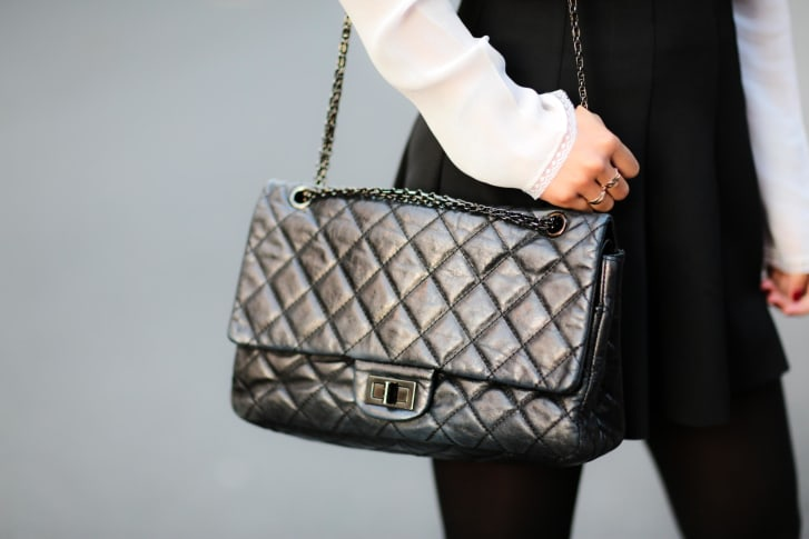 Fashion and lifestyle blogger May Berthelot sporting a Chanel 2.55 bag in Paris, France.