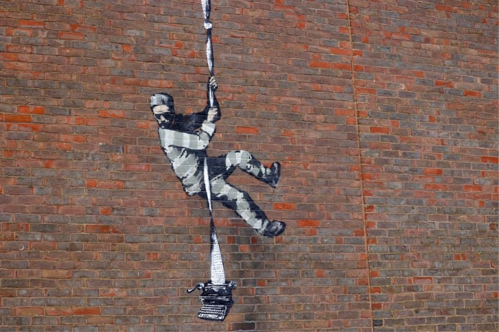 The mural appeared at Reading Prison on Monday.