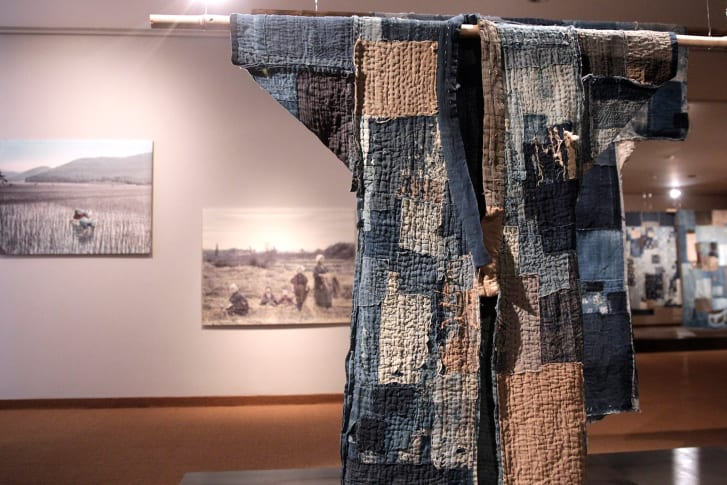 An exhibition featuring garments made of boro textiles at The Museum of East Asian Art in 2015.