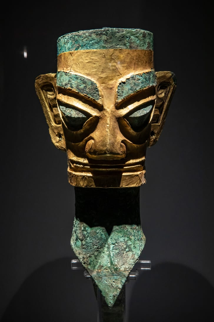 A bronze head and mask uncovered from Sanxingdui in 1986, when the first sacrificial pits were found at the site.