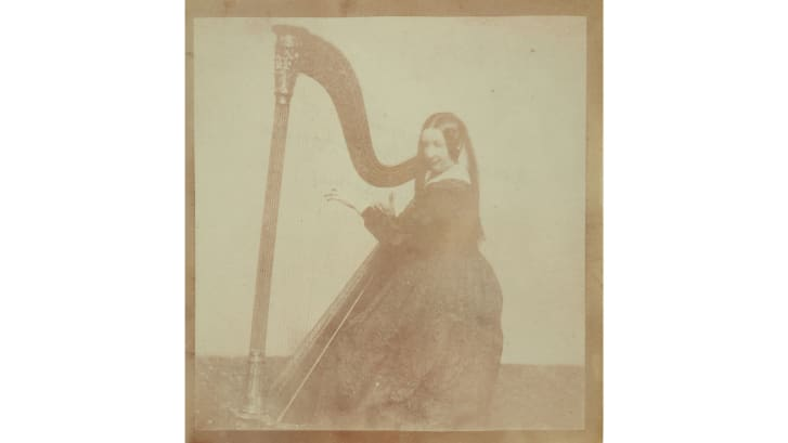Talbot's sister, Henrietta Horatia Maria Gaisford, pictured playing the harp.
