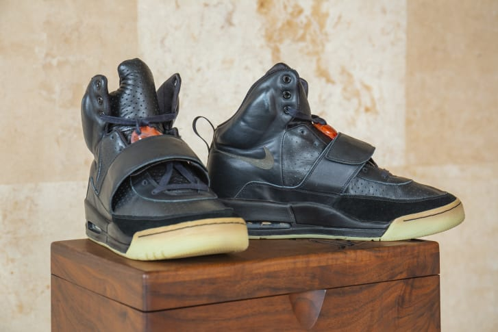 The shoes come in a custom wooden box featuring a lazered design and etching by Mark Smith, who designed the sneakers.