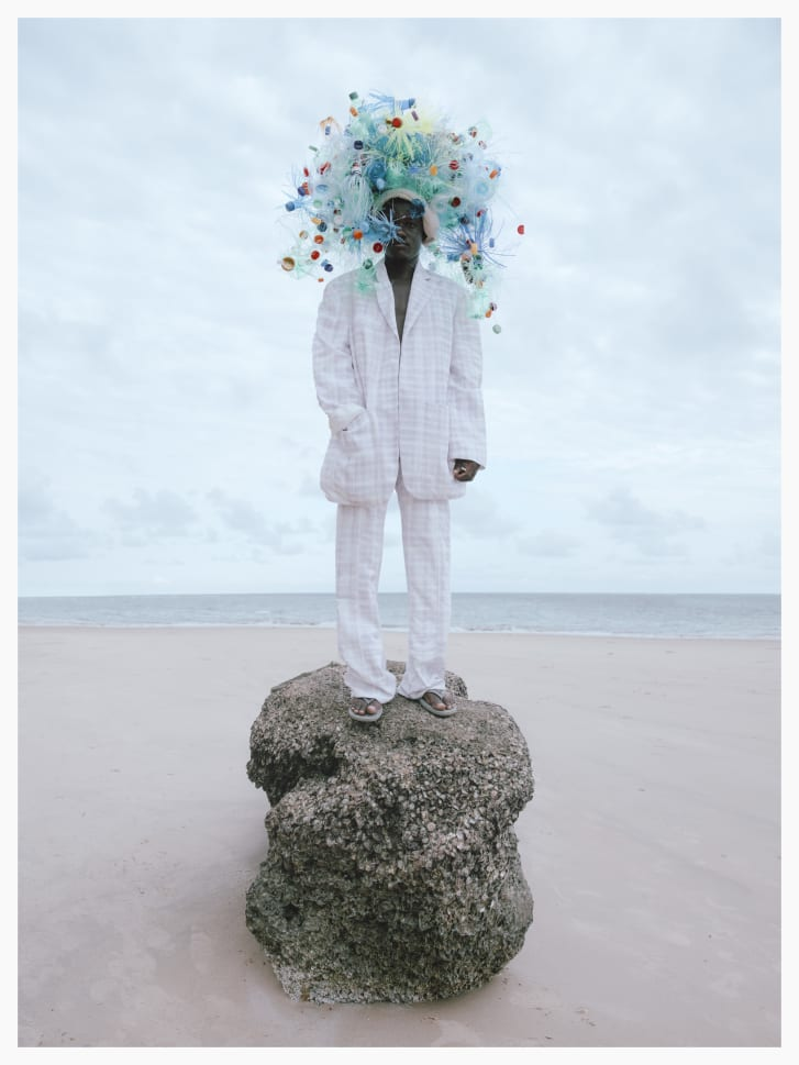 """In 2020, Moolman took part in a virtual photography show, """"28 Hats for Lamu."""" The photos, featuring eccentric headpieces, celebrate the transformative power of creativity."""