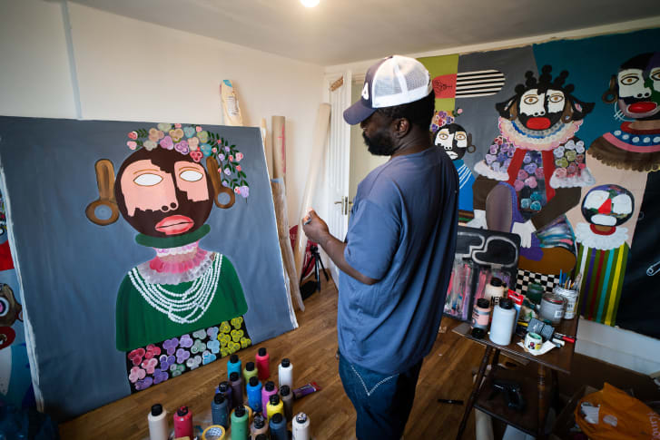 Artist Kojo Marfo working from his home studio in south London.