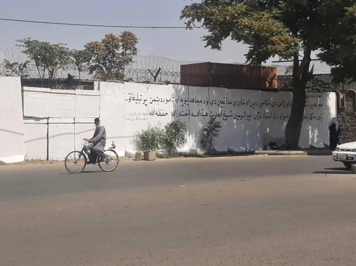 """Taliban paint over mural in Kabul and replace it with text that reads """"don't trust the propaganda of the enemy""""."""