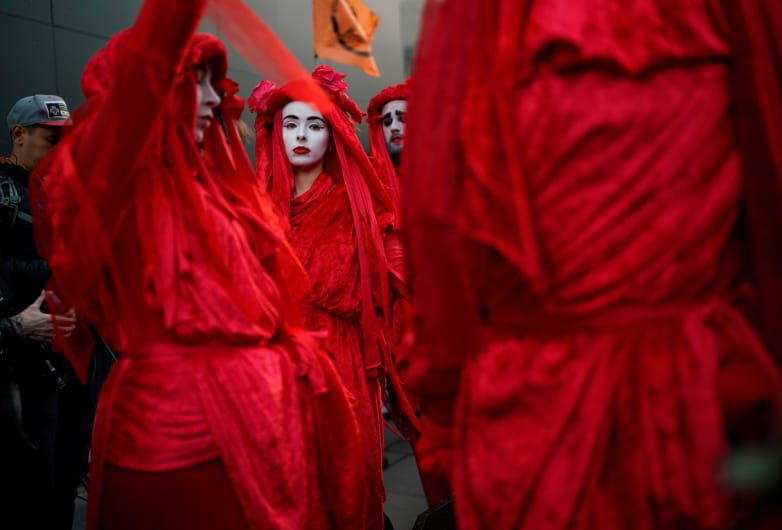 Protesters cloaked in red gathered for an Extinction Rebellion demonstration on Tuesday in London.