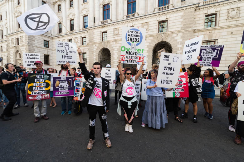 Extinction Rebellion activists protested outside Victoria Beckham's London Fashion Week Show Sunday.