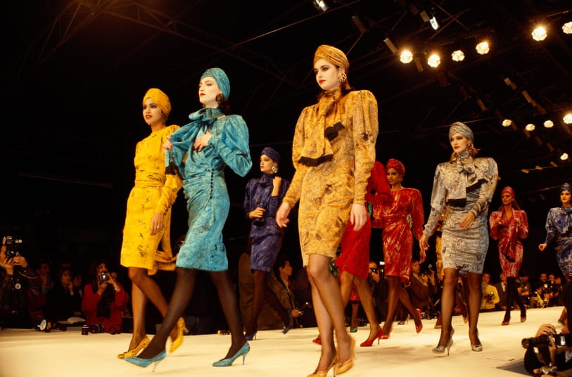 Models wear bright colored suits with matching turbans by  designer Kenzo Takada at his Autumn-Winter show in Paris, 1986.