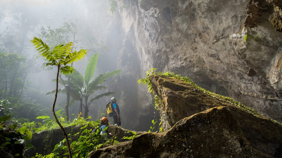 Hang Son Doong is so massive that it contains its own jungle, underground river and localized weather system. Clouds form inside the cave and spew out from the exits and dolines, which gave the first explorers a clue as to how large Hang Son Doong really is | Alesha Bradford