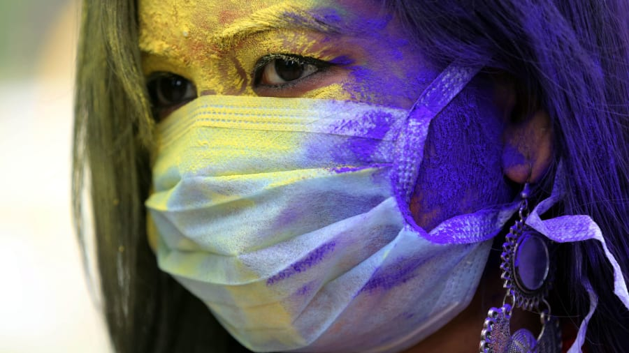 Holi celebrated with face masks and color explosions amid coronavirus fears