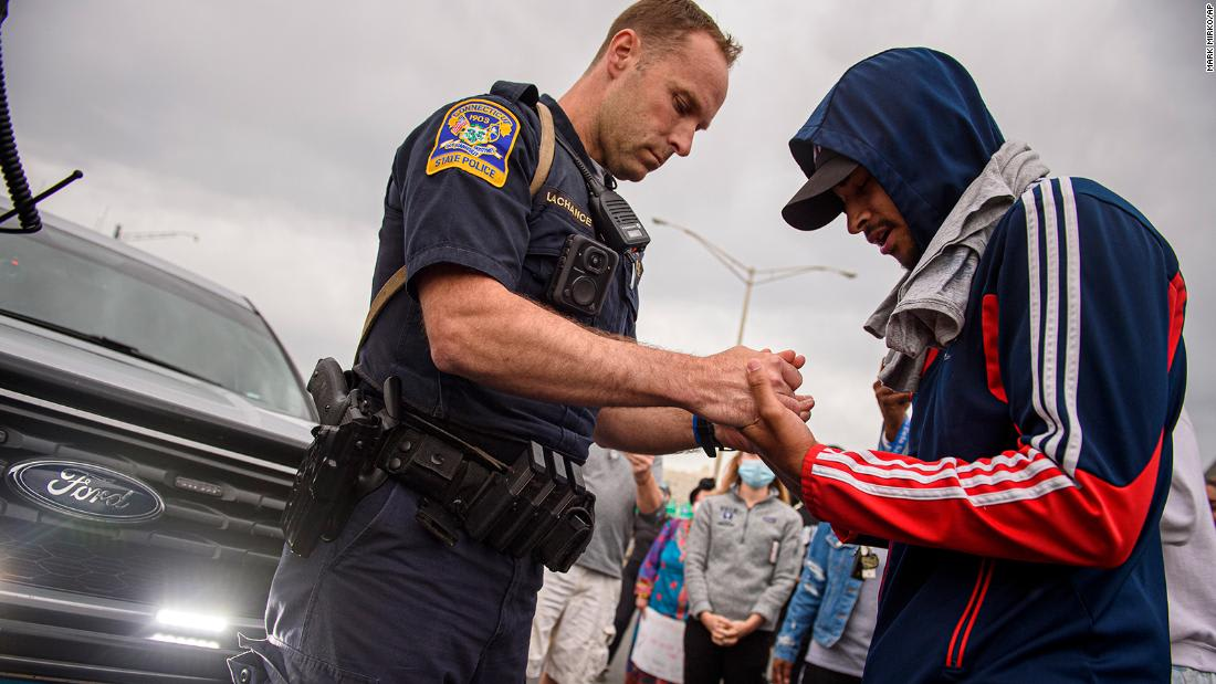 Some police officers are showing solidarity with protesters in several US cities