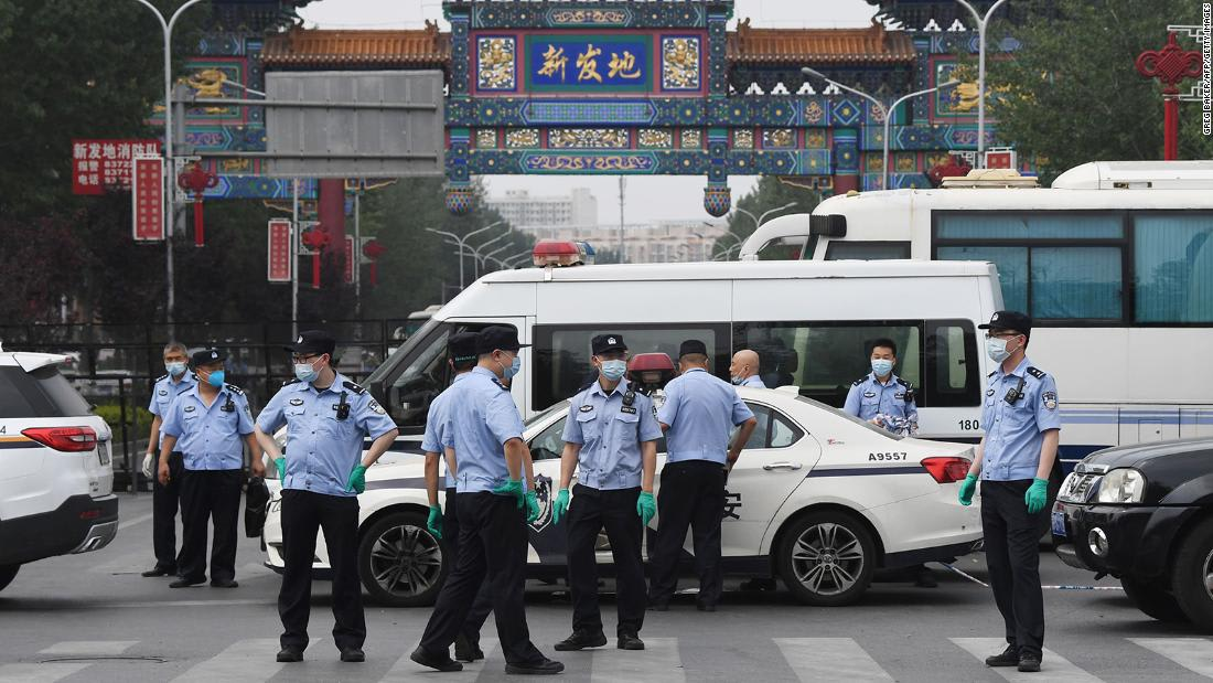 China's new coronavirus outbreak sees Beijing adopt 'wartime' measures
