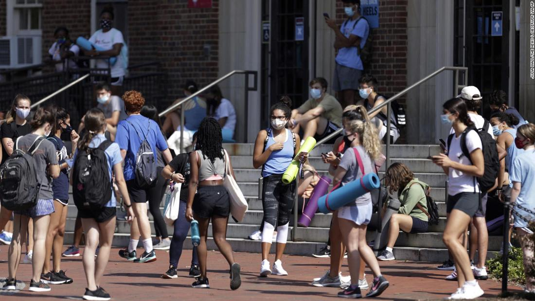 Colleges and universities across US halt in-person classes and begin campus monitoring after rising coronavirus cases
