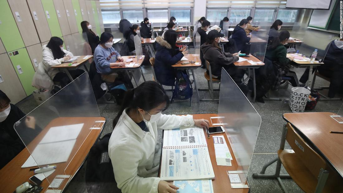 Half a million South Korean students sit a college entrance exam despite rising Covid cases